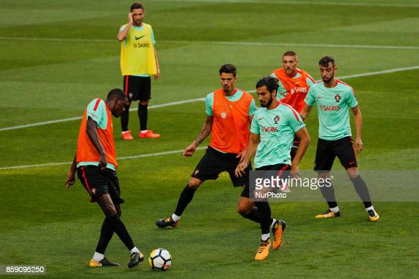 Portuguese midfielders William Carvalho Andre Gomes Bruno Fernandes and defenders Jose Fonte Antunes during National Team Training session before the...