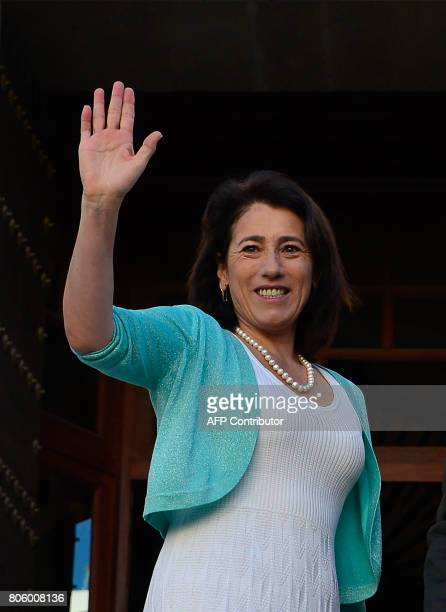 Portuguese Minister of Interior Constança Urbano de Sousa waves as she poses before a meeting at the 'Archivo General de Indias' in Seville on July 3...