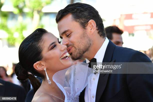 Portuguese model Sara Sampaio and her partner Oliver Ripley kiss as they arrive on May 20 2017 for the screening of the film '120 Beats Per Minute '...