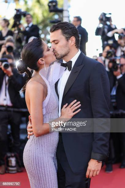 Portuguese model Sara Sampaio and her partner Oliver Ripley smile as they arrive on May 20 2017 for the screening of the film '120 Beats Per Minute '...