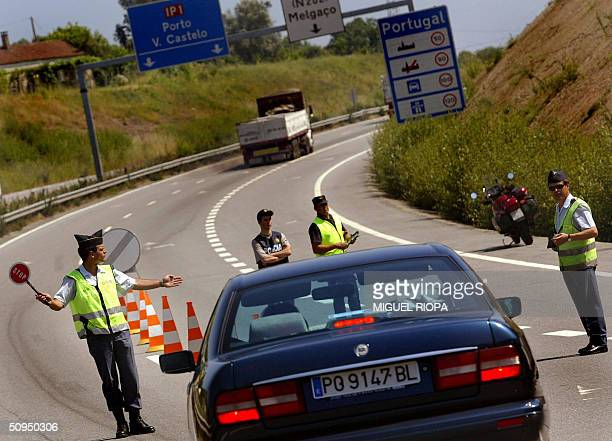Portuguese national police stop a car at the border between Portugal and Spain in Valenca do Minho northern Portugal 11 June 2004 Portuguese...