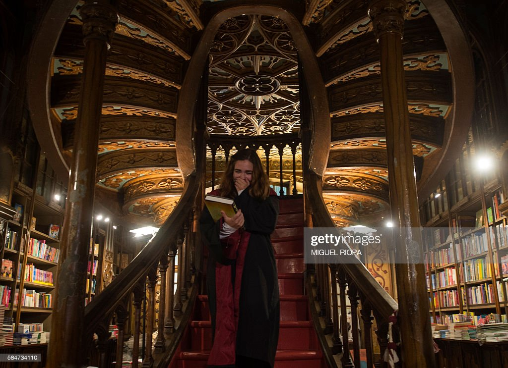 Portuguese Patricia Camarada gestures after purchasing the first copy of British author JK Rowlings latest book in the Potter series Harry Potter and...