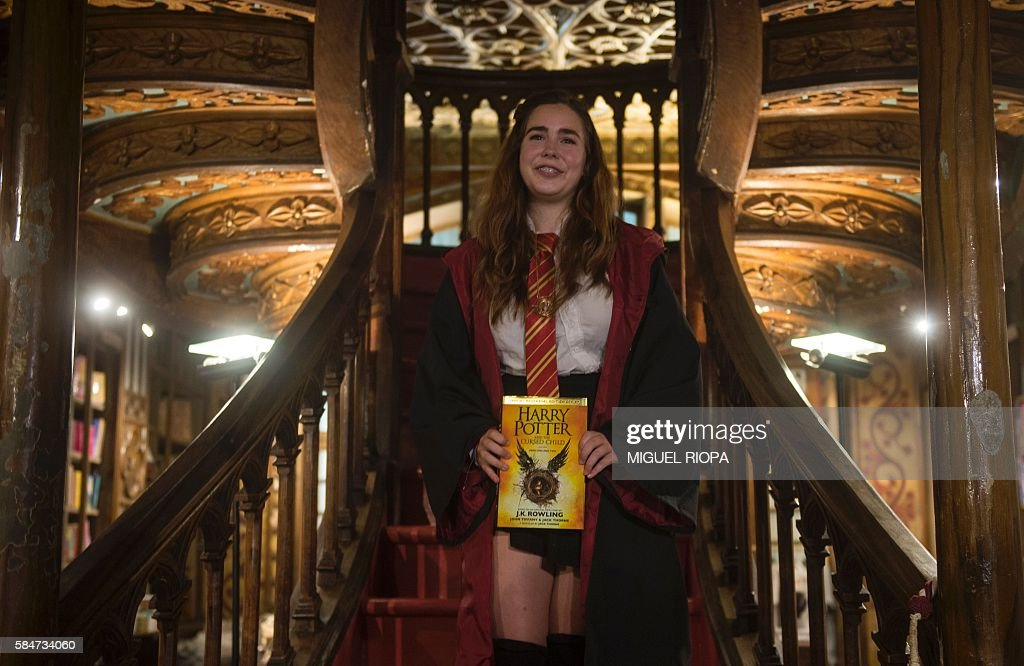 Portuguese Patricia Camarada smiles after purchasing the first copy of British author JK Rowlings latest book in the Potter series Harry Potter and...