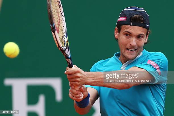 Portuguese player Joao Sousa returns a ball to Canadian player Milos Raonic during their MonteCarlo ATP Masters Series Tournament tennis match on...
