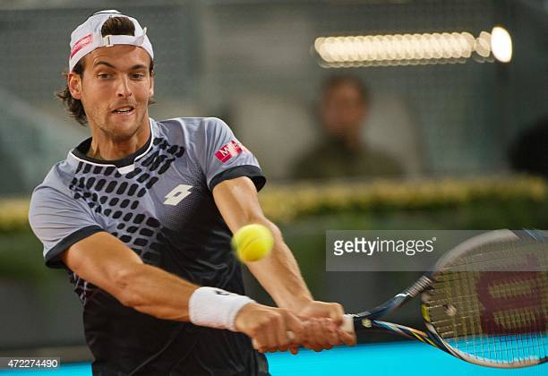Portuguese player Joao Sousa returns a ball to Swiss tennis player Stan Wawrinka during day four of the Madrid Open tournament at the Caja Magica...