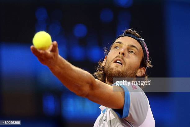 Portuguese player Joao Sousa serves against Austrian player Dominic Thiem during the final match of the ATP Croatia Open tennis tournament on July 26...