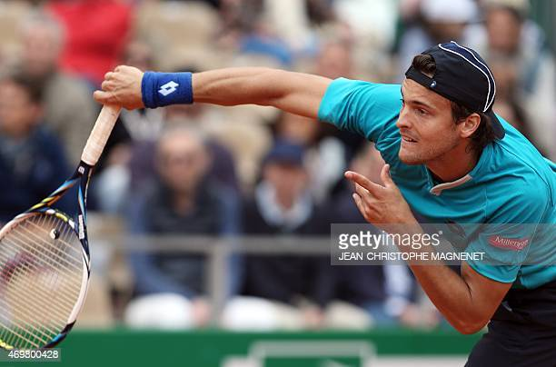 Portuguese player Joao Sousa serves to Canadian player Milos Raonic during their MonteCarlo ATP Masters Series Tournament tennis match on April 15...