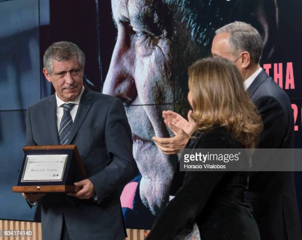 Portuguese President Marcelo Rebelo de Sousa and the president of the Foreign Press Association in Portugal Begona Iniguez applaud after Portugal...