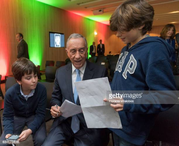Portuguese President Marcelo Rebelo de Sousa chats with two children at the end of the ceremony in which he gave Portugal national soccer team coach...