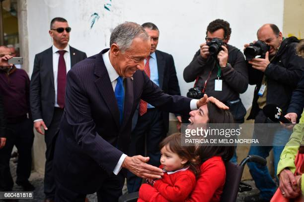Portuguese President Marcelo Rebelo de Sousa cheers locals as he accompanies Chilean President on the first day of her two days official visit to...