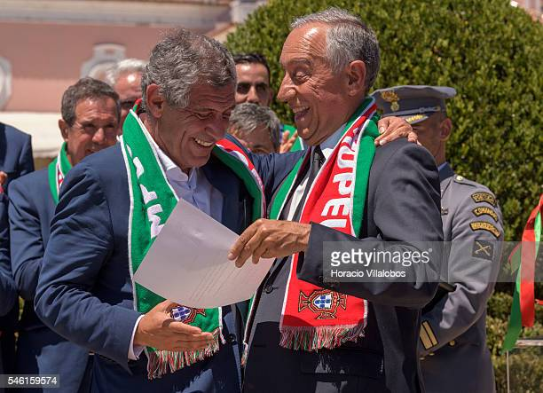 Portuguese President Marcelo Rebelo de Sousa decorates National Soccer Team coach Fernando Santos with the Grand Cross of the Order of Merit on July...