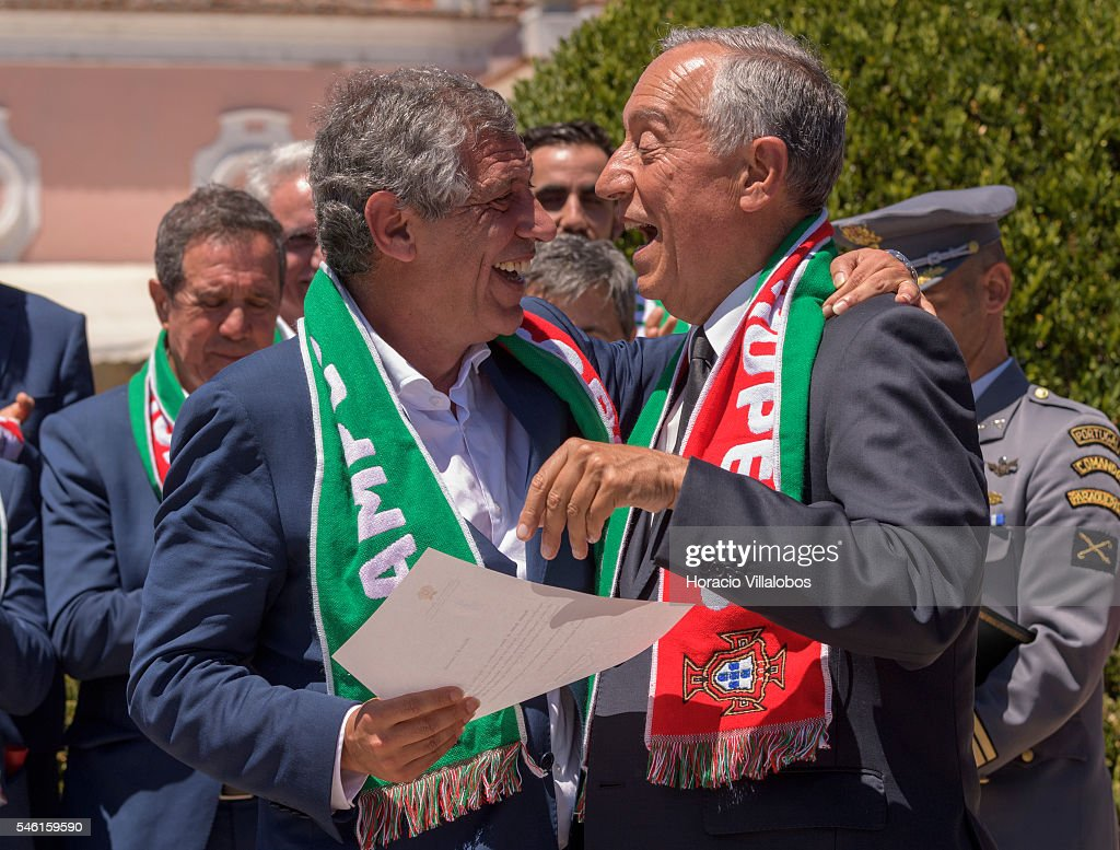 Portuguese President Marcelo Rebelo de Sousa (R) decorates National Soccer Team coach Fernando Santos with the Grand Cross of the Order of Merit on July 11, 2016 in Lisbon, Portugal. Portuguese player Eder scored the winning goal against France in extra time and Portugal won the Euro 2016.