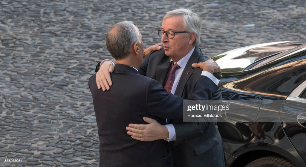 Portuguese President Marcelo Rebelo de Sousa (L) embraces the President of the European Commission Jean-Claude Juncker (R) at his arrival in Belem Palace on October 30, 2017 in Lisbon, Portugal. Mr. Juncker is on a two-days visit to Portugal during which he also meets with Portugal's Prime Minister and will receive an Honoris Causa Doctorate at the University of Coimbra.