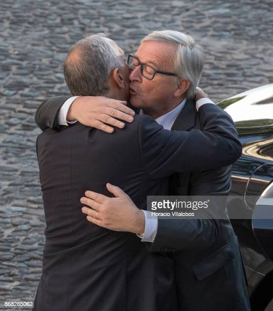 Portuguese President Marcelo Rebelo de Sousa embraces the President of the European Commission JeanClaude Juncker at his arrival in Belem Palace on...