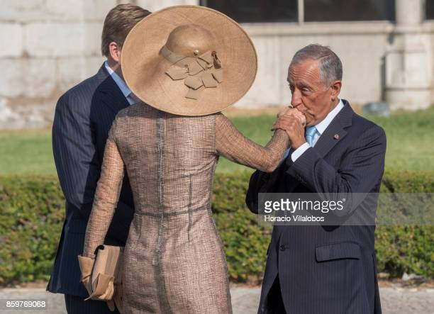 Portuguese President Marcelo Rebelo de Sousa greets King WillemAlexander of The Netherlands and Queen Maxima of The Netherlands outside Jeronimos...