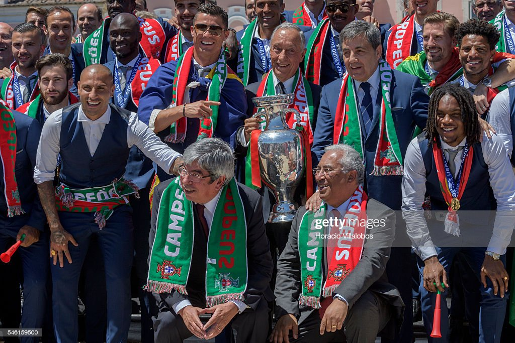 Portuguese President Marcelo Rebelo de Sousa holds the Euro 2016 trophy surrounded by the National Soccer Team and flanked by Cristiano Ronaldo (L), the president of the FPF Fernando Gomes (R), the president of the Assembly of the Republic Eduardo Ferro Rodrigues (down L) and Portuguese Prime Minister Antonio Costa (down R) at the presidential palace where he greeted and decorated them with the Grand Cross of the Order of Merit on July 11, 2016 in Lisbon, Portugal. Portuguese player Eder scored the winning goal against France in extra time and Portugal won the Euro 2016.