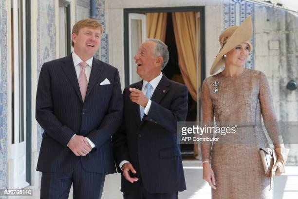 Portuguese President Marcelo Rebelo de Sousa speaks with King WillemAlexander and Queen Maxima of the Netherlands during a meeting at the Belem...