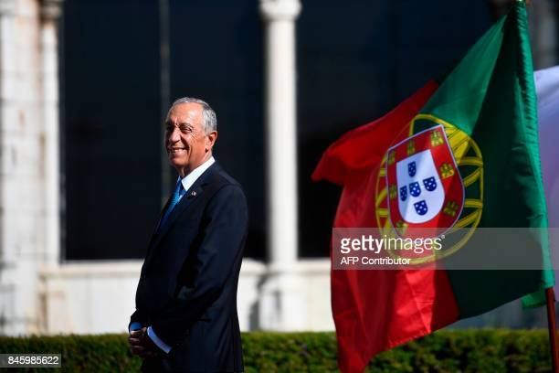 Portuguese President Marcelo Rebelo de Sousa waits for his Ivorian counterpart at the Jeronimos Monastery in Belem Lisbon on September 12 2017 / AFP...