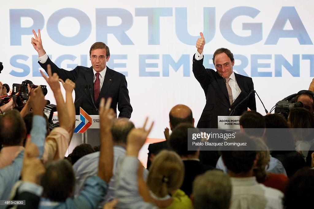 Portuguese Prime Minister and Social Democratic Party's leader <a gi-track='captionPersonalityLinkClicked' href=/galleries/search?phrase=Pedro+Passos+Coelho&family=editorial&specificpeople=6912340 ng-click='$event.stopPropagation()'>Pedro Passos Coelho</a> (L) and Portuguese deputy prime minister <a gi-track='captionPersonalityLinkClicked' href=/galleries/search?phrase=Paulo+Portas&family=editorial&specificpeople=2555155 ng-click='$event.stopPropagation()'>Paulo Portas</a> (R) celebrates winning the general elections in front of his supporters at Sana Hotel on October 4, 2015 in Lisbon, Portugal. Portuguese Prime Minister and Social Democratic Party's leader <a gi-track='captionPersonalityLinkClicked' href=/galleries/search?phrase=Pedro+Passos+Coelho&family=editorial&specificpeople=6912340 ng-click='$event.stopPropagation()'>Pedro Passos Coelho</a>'s coalition won the general election, becoming the first prime minister to be re-elected among the five eurozone states. Since 2011, Coelho's government made some tough austerity measures.