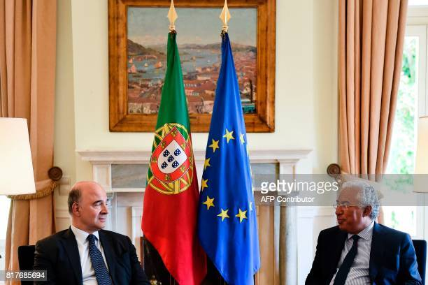 Portuguese Prime Minister Antonio Costa and European Economic and Financial Affairs Commissioner Pierre Moscovici sit during their meeting at Sao...