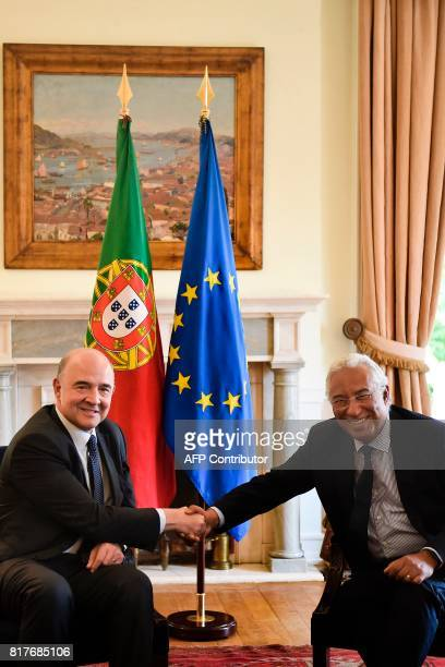 Portuguese Prime Minister Antonio Costa greets the European Economic and Financial Affairs Commissioner Pierre Moscovici during a meeting at Sao...