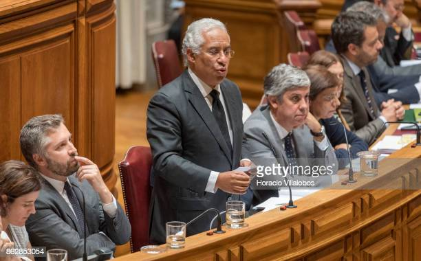 Portuguese Prime Minister Antonio Costa is flanked by his cabinet of ministers while answering to lawmakers questions on Portugal's recent forest...