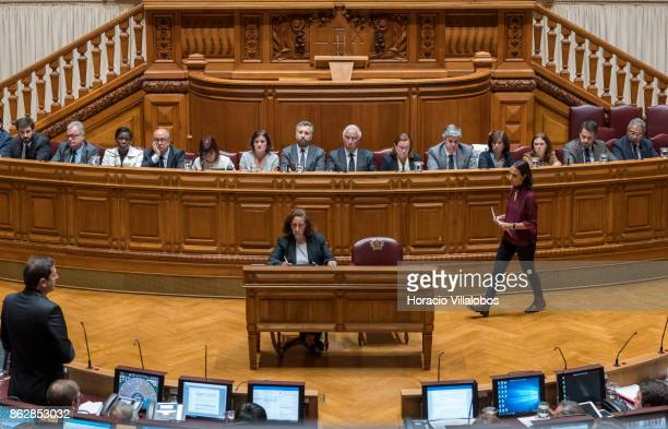 Portuguese Prime Minister Antonio Costa sits flanked by his cabinet of ministers while listening to a parliamentarian remarks on Portugal recent...