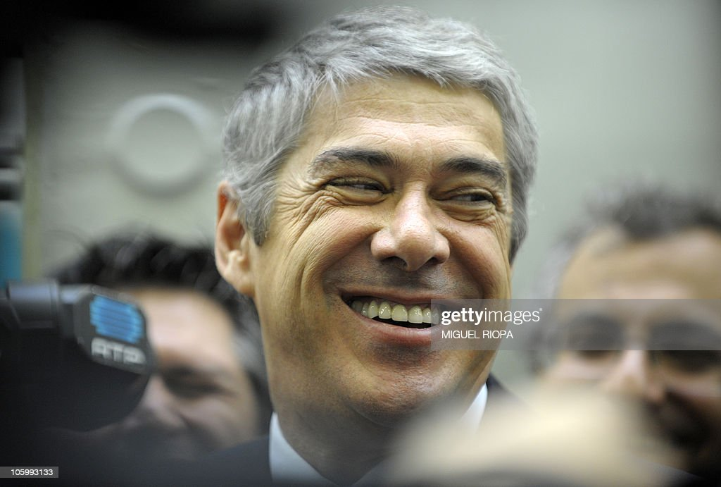 Portuguese Prime Minister <a gi-track='captionPersonalityLinkClicked' href=/galleries/search?phrase=Jose+Socrates&family=editorial&specificpeople=548562 ng-click='$event.stopPropagation()'>Jose Socrates</a> smiles as he chats with Venezuela´s President Hugo Chavez (unseen) in Viana do Castelo, northern Portugal on October 24, 2010. Portugal is the last stop of an international tour which has also taken him in Libya, Russia, Belarus, Ukraine, Syria and Iran.