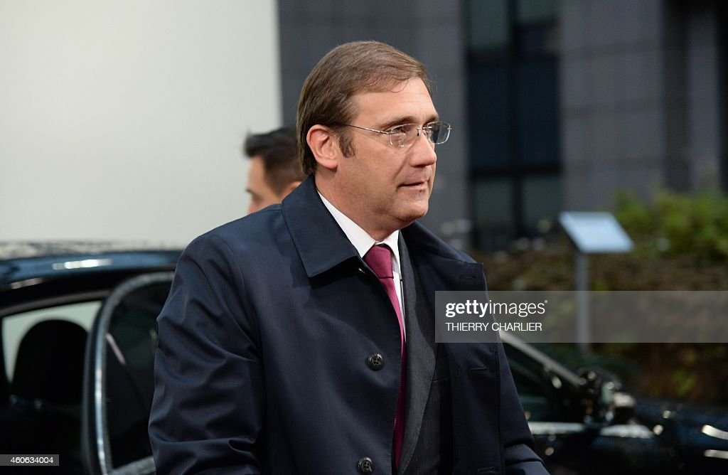Portuguese Prime Minister <a gi-track='captionPersonalityLinkClicked' href=/galleries/search?phrase=Pedro+Passos+Coelho&family=editorial&specificpeople=6912340 ng-click='$event.stopPropagation()'>Pedro Passos Coelho</a> arrives ahead of the European Union summit at the EU headquarters in Brussels on December 18, 2014. EU leaders are due to review overall ties with Russia at the summit which, according to a draft communique, will restate their position that further sanctions depend on the situation on the ground.