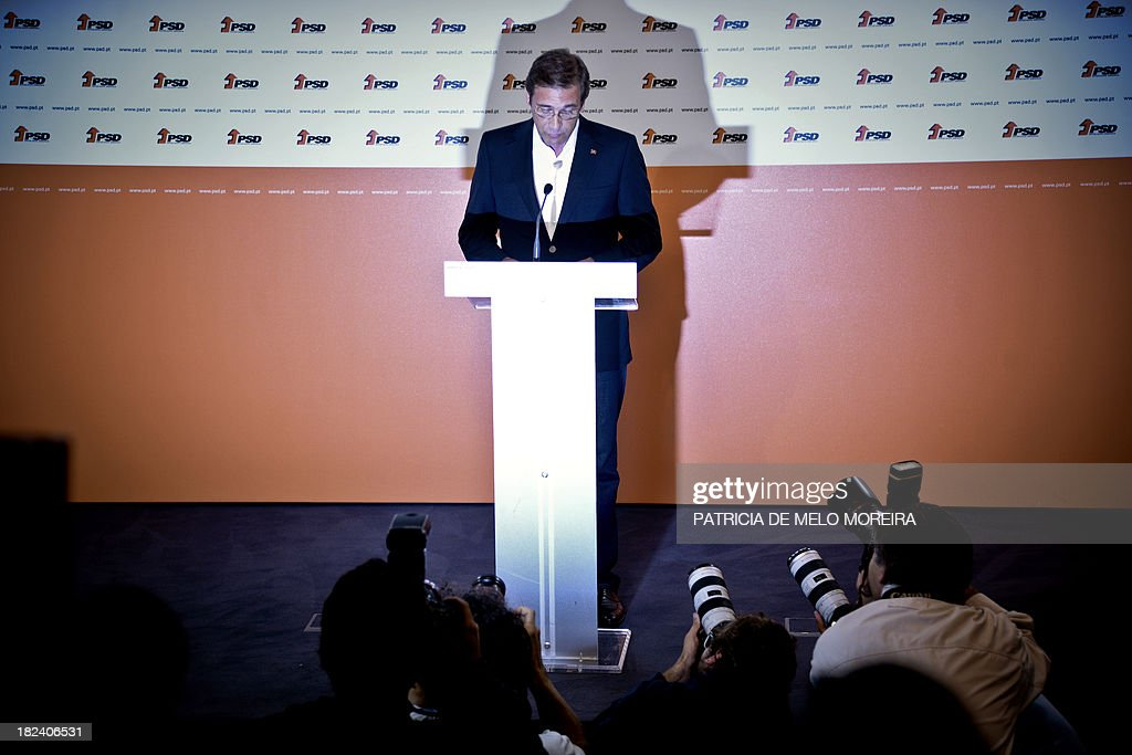 Portuguese Prime Minister Pedro Passos Coelho delivers a speech after the results of Portugal local elections at SDP (Social Democrats Party) headquarters in a Lisbon, on September 29, 2013. The opposition Socialists retained power in the capital Lisbon, with an increased share of the vote, and Prime Minister Passos Coelho's centre-right Social Democratic Party lost control of Portugal's second city Porto.