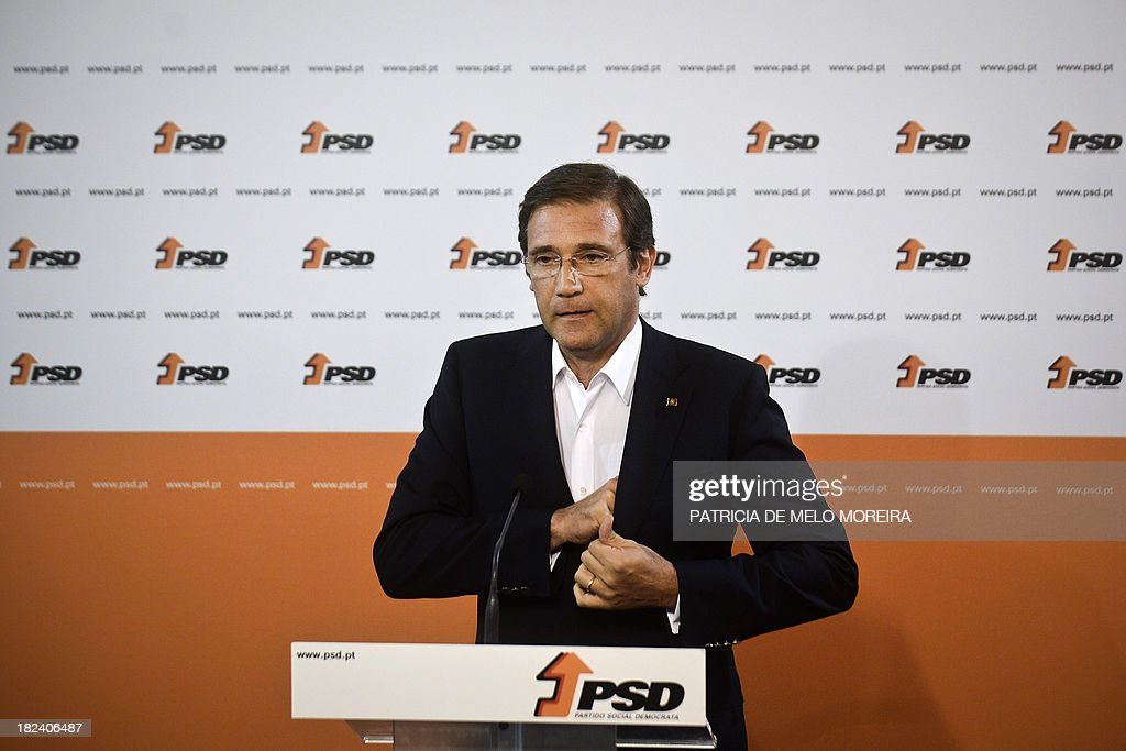 Portuguese Prime Minister Pedro Passos Coelho gestures as he delivers a speech after the results of Portugal local elections at SDP (Social Democrats Party) headquarters in a Lisbon, on September 29, 2013. The opposition Socialists retained power in the capital Lisbon, with an increased share of the vote, and Prime Minister Passos Coelho's centre-right Social Democratic Party lost control of Portugal's second city Porto. AFP PHOTO/ PATRICIA DE MELO MOREIRA