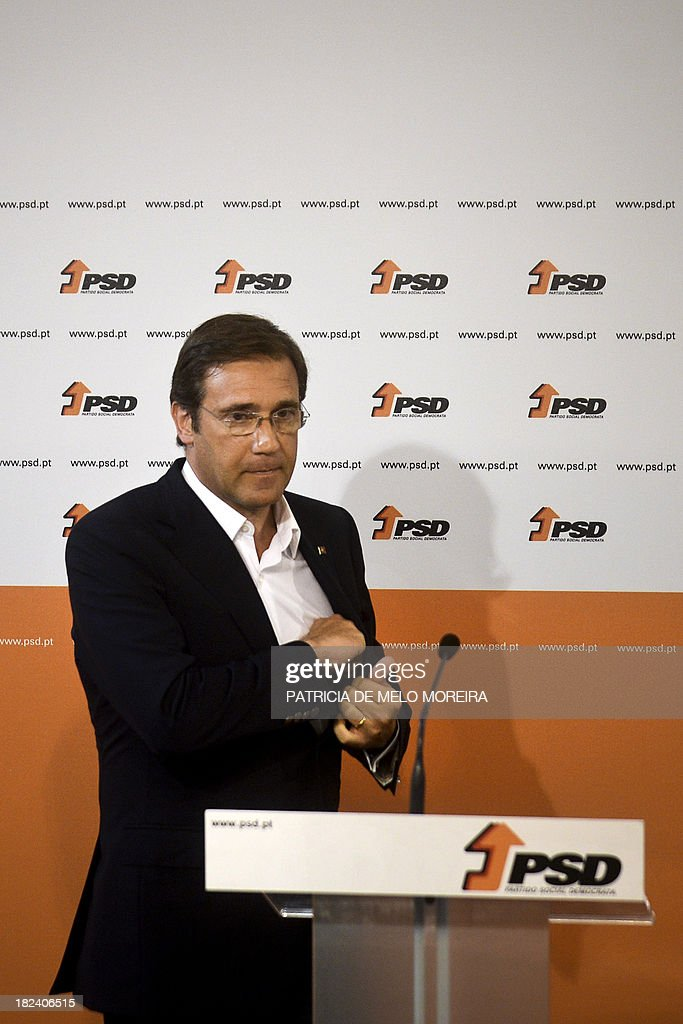 Portuguese Prime Minister Pedro Passos Coelho gestures as he delivers a speech after the results of Portugal local elections at SDP (Social Democrats Party) headquarters in a Lisbon, on September 29, 2013. The opposition Socialists retained power in the capital Lisbon, with an increased share of the vote, and Prime Minister Passos Coelho's centre-right Social Democratic Party lost control of Portugal's second city Porto.