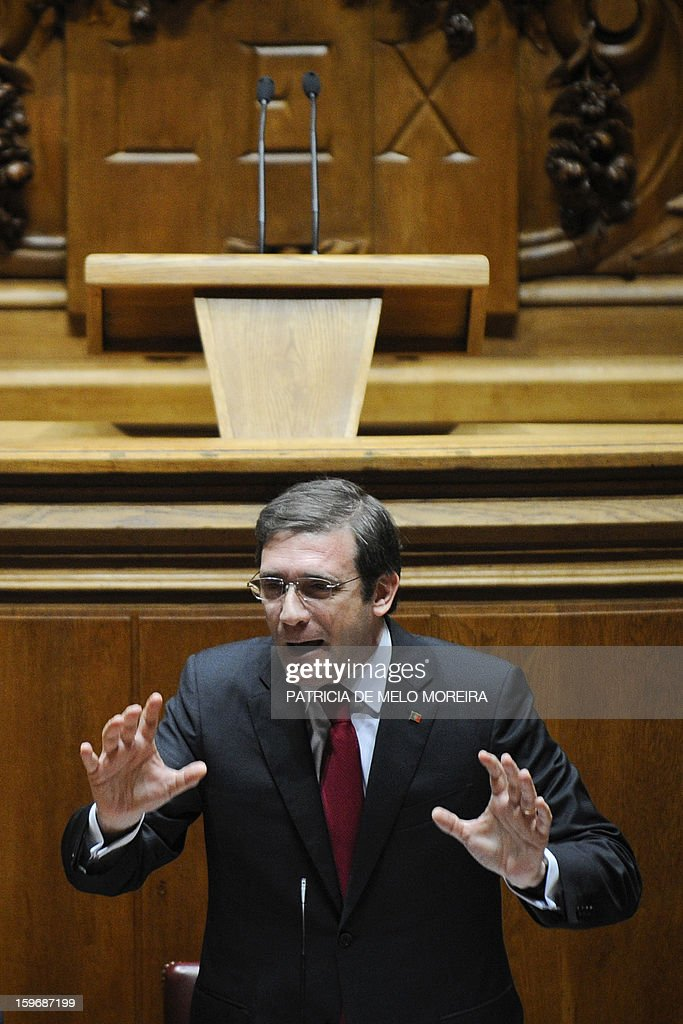 Portuguese Prime Minister Pedro Passos Coelho gestures as he speaks during a plenary session at the Parliament in Lisbon, on January 18, 2013.