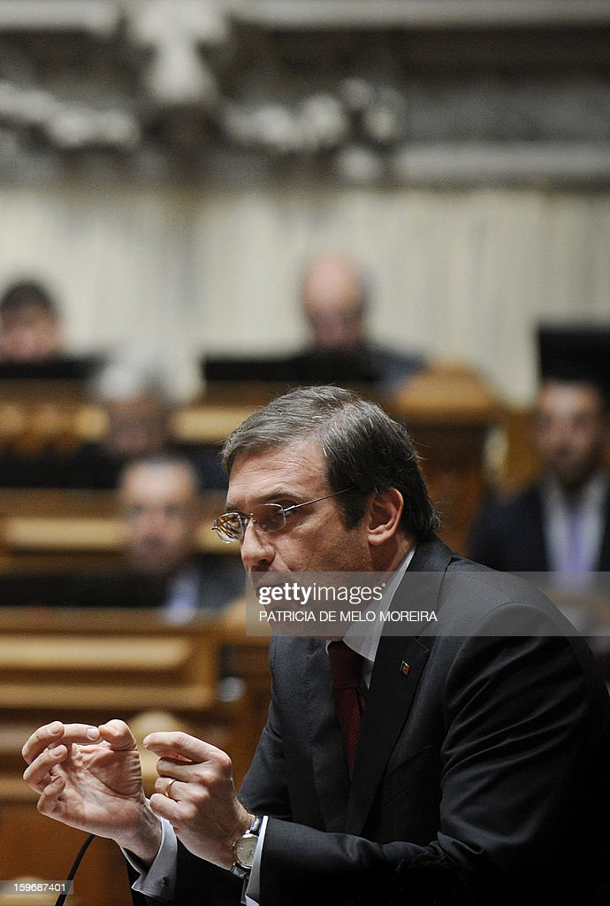 Portuguese Prime Minister Pedro Passos Coelho gestures as he speaks during a plenary session at the Parliament in Lisbon, on January 18, 2013. AFP PHOTO/ PATRICIA DE MELO MOREIRA
