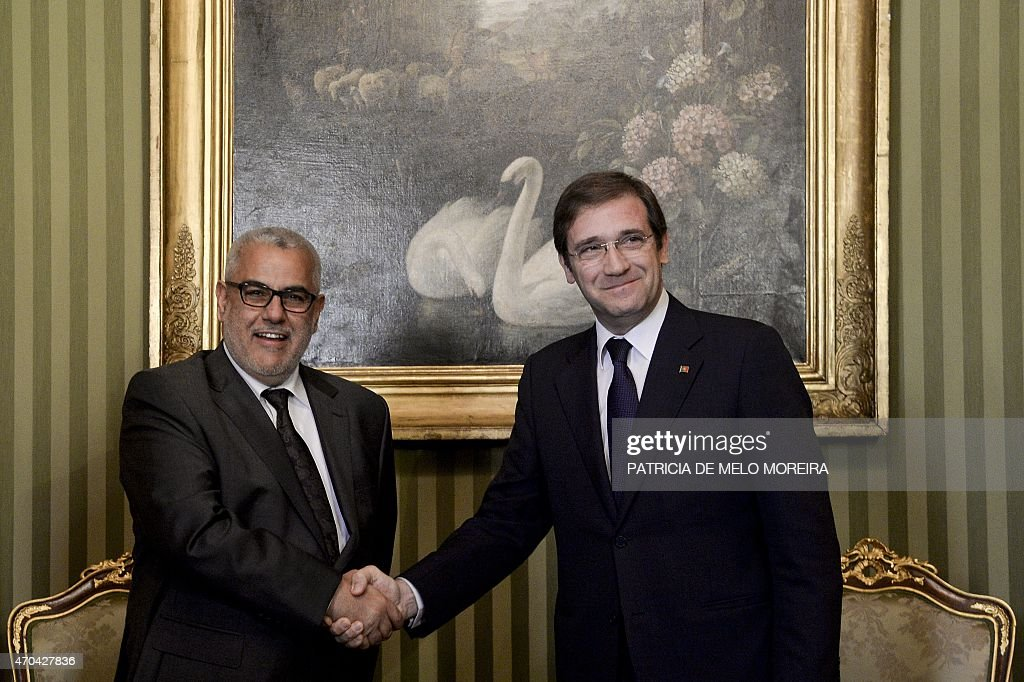 Portuguese Prime Minister <a gi-track='captionPersonalityLinkClicked' href=/galleries/search?phrase=Pedro+Passos+Coelho&family=editorial&specificpeople=6912340 ng-click='$event.stopPropagation()'>Pedro Passos Coelho</a> (R) shakes hands with his Moroccan counterpart Abdelilah Benkirane (L) prior to meeting during the Portugal-Morocco Summit at Necessidades Palace in Lisbon on April 20, 2015.