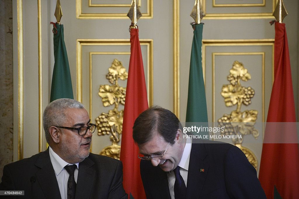 Portuguese Prime Minister <a gi-track='captionPersonalityLinkClicked' href=/galleries/search?phrase=Pedro+Passos+Coelho&family=editorial&specificpeople=6912340 ng-click='$event.stopPropagation()'>Pedro Passos Coelho</a> (R) smiles during a joint press conference as he listens to his Moroccan counterpart Abdelilah Benkirane (L) during the Portugal-Morocco Summit at Necessidades Palace in Lisbon on April 20, 2015.
