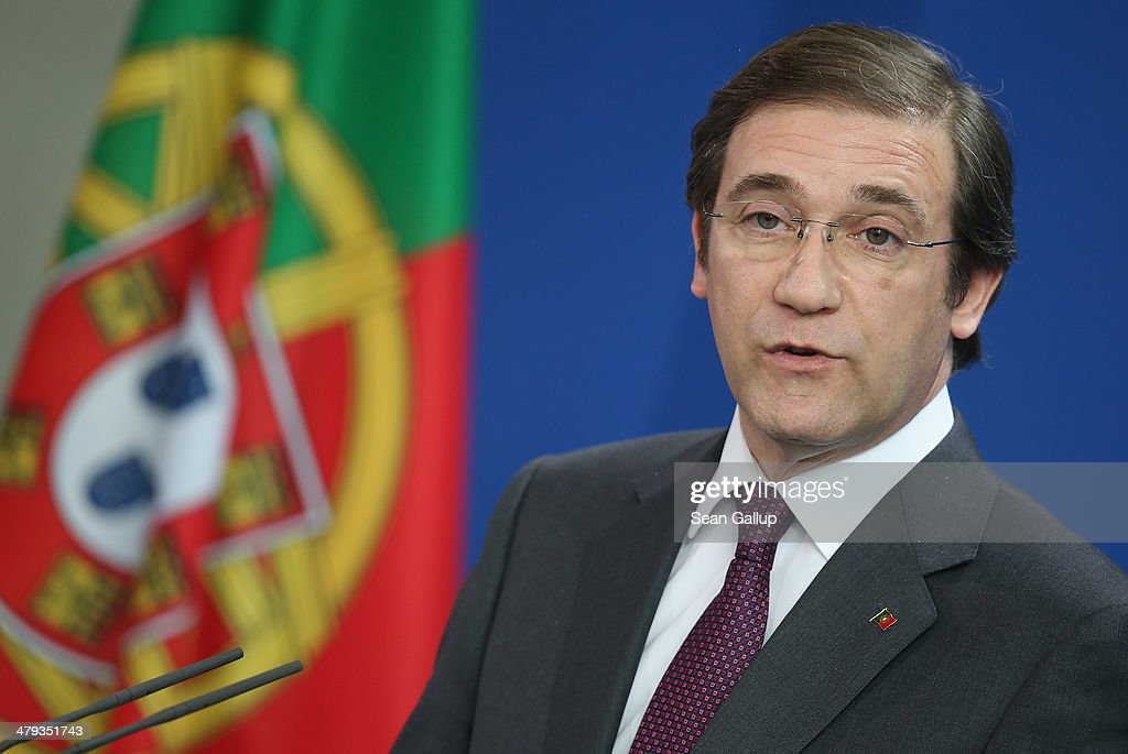Portuguese Prime Minister <a gi-track='captionPersonalityLinkClicked' href=/galleries/search?phrase=Pedro+Passos+Coelho&family=editorial&specificpeople=6912340 ng-click='$event.stopPropagation()'>Pedro Passos Coelho</a> speaks to the media with German Chancellor Angela Merkel (not pictured) following bilateral talks at the Chancellery on March 18, 2014 in Berlin, Germany. Merkel praised Portugal's reform efforts since the European financial crisis.