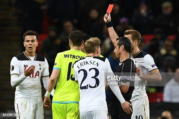 TOPSHOT Portuguese referee Jorge Sousa shows a straight red card to send off Tottenham Hotspur's English midfielder Dele Alli during the UEFA Europa...