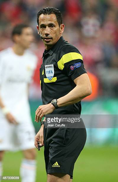 Portuguese referee Pedro Proenca looks on during the UEFA Champions League semifinal second leg match between FC Bayern Muenchen and Real Madrid at...