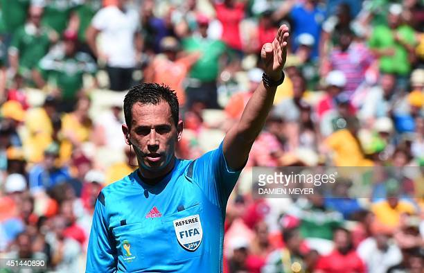 Portuguese referee Pedro Proenca Oliveira Alves Garcia gestures during a Round of 16 football match between Netherlands and Mexico at Castelao...