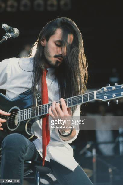 Portuguese singersongwriter and guitarist Nuno Bettencourt of Extreme performing at Wembley Stadium London during the The Freddie Mercury Tribute...