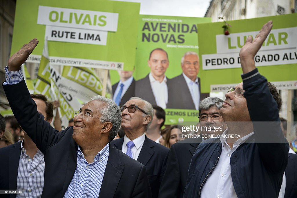 Portuguese Socialist Party general secretary Antonio Jose Seguro and Lisbon's mayoral candidate Antonio Costa wave to supporters during a campaign...