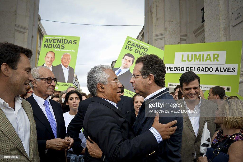 Portuguese Socialist Party general secretary Antonio Jose Seguro embraces Lisbon mayoral candidate Antonio Costa during a campaign visit in downtown...