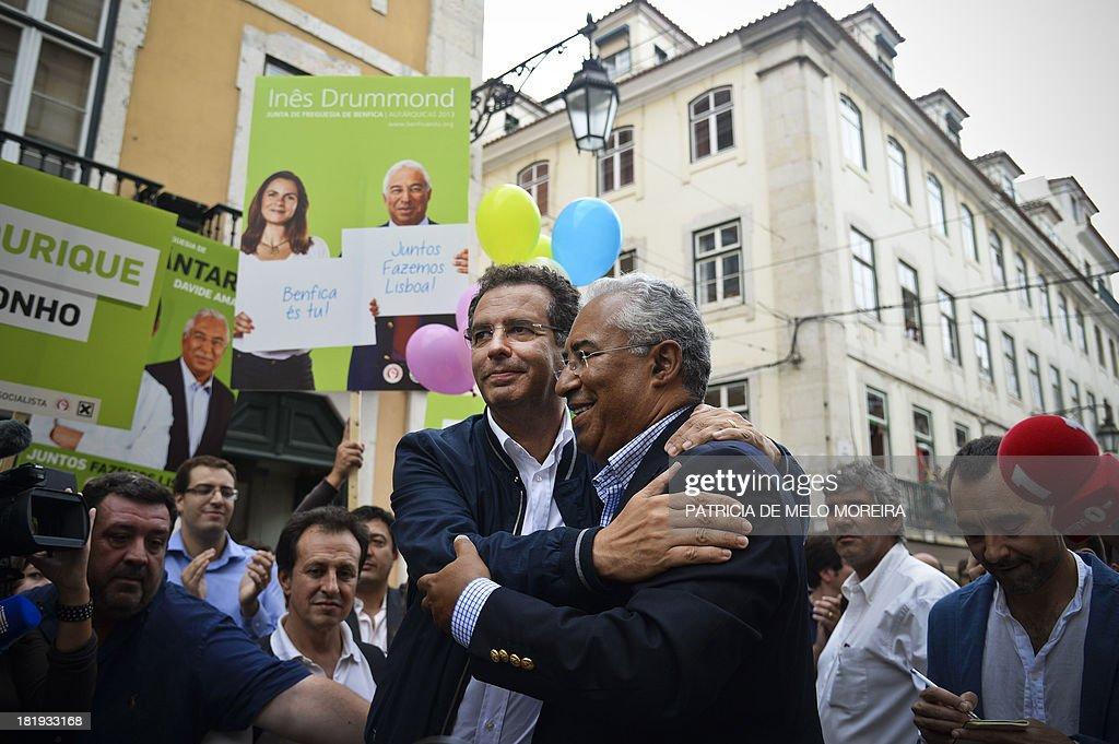 Portuguese Socialist Party general secretary Antonio Jose Seguro embraces Lisbon's mayoral candidate Antonio Costa during a campaign rally in...