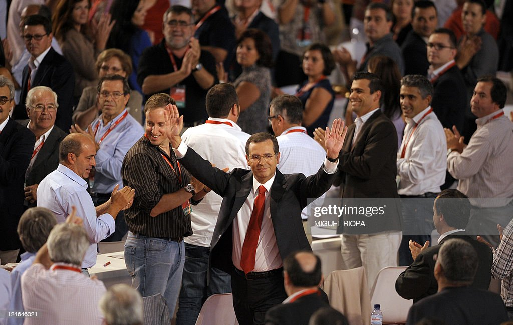 Portuguese Socialist Party GeneralSecretary Antonio Jose Seguro waves on September 11 2011 at delegates after arriving at the XVIII Congress of the...