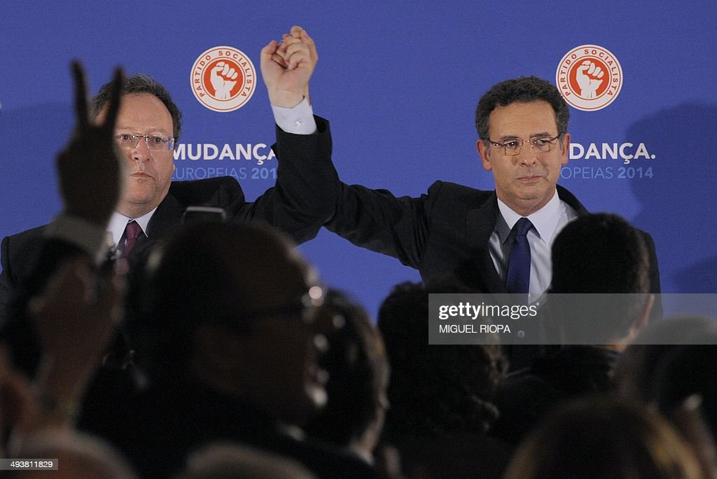 Portuguese Socialist Party's Secretary General Antonio Jose Seguro and PS's candidate Francisco Assis react after the announcement of the European...