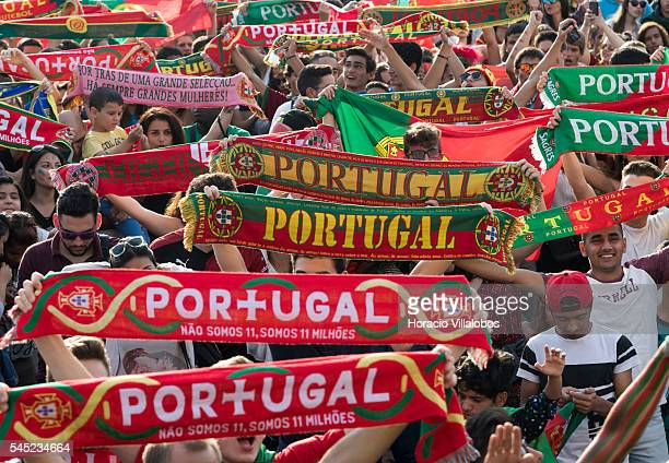 Portuguese supporters cheer their national team while watching it playing against Wales for semifinals of UEFA Euro 2016 on a giant screen set up in...
