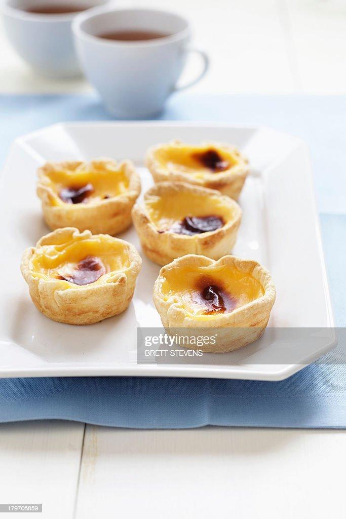 Portuguese tarts and tea : Stock Photo