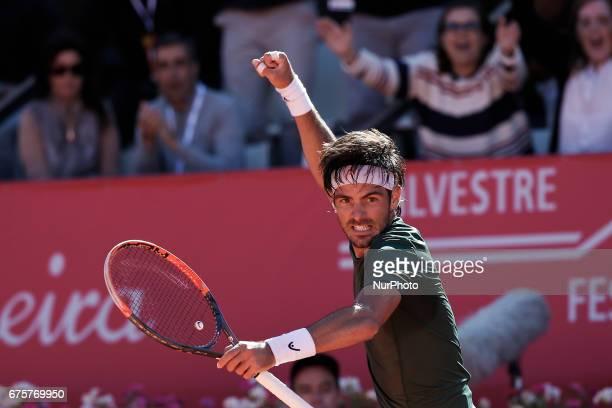 Portuguese tennis player Gastao Elias celebrates after winning Millennium Estoril Open ATP Singles 1st round tennis match against Tunisian player...