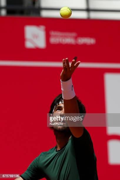 Portuguese tennis player Gastao Elias serves to Tunisian player Malek Jaziri during their Millennium Estoril Open ATP Singles 1st round tennis match...